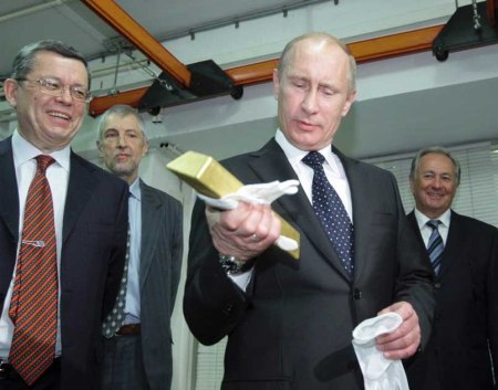 Putin holds a gold ignot