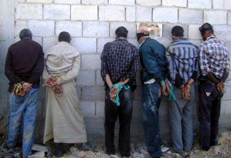 detained men blindfolded