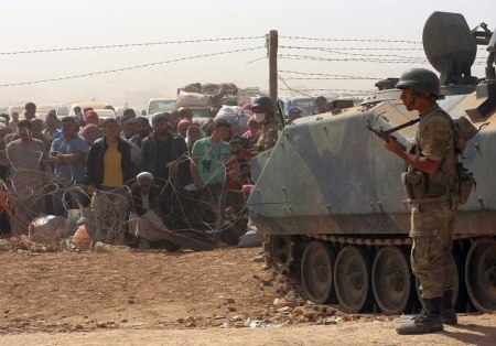 Turkish soldiers Kurdish refugees