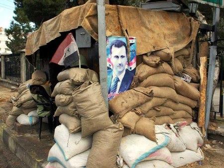 Assad poster barricade