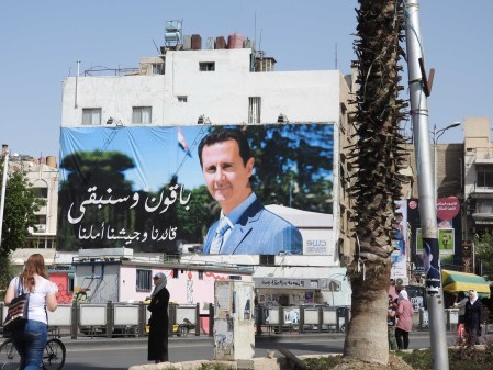 Assad huge poster