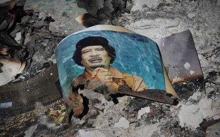 Gaddafi poster dust