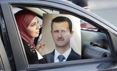 woman-assad-poster-car